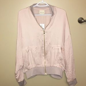 Urban Outfitters pink satin bomber